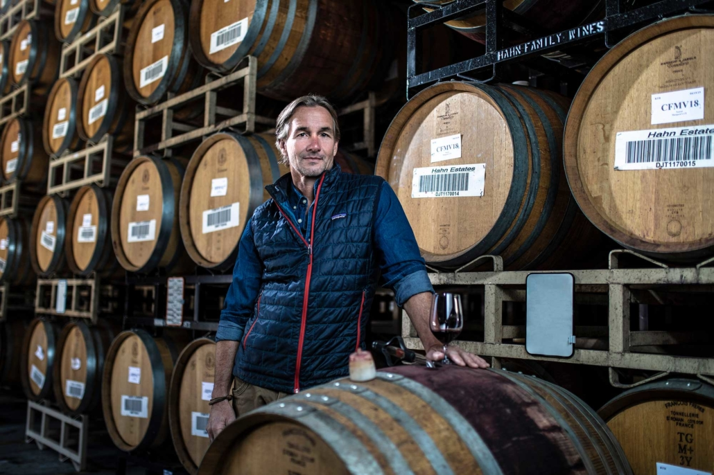 Paul Clifton beside wine barrels